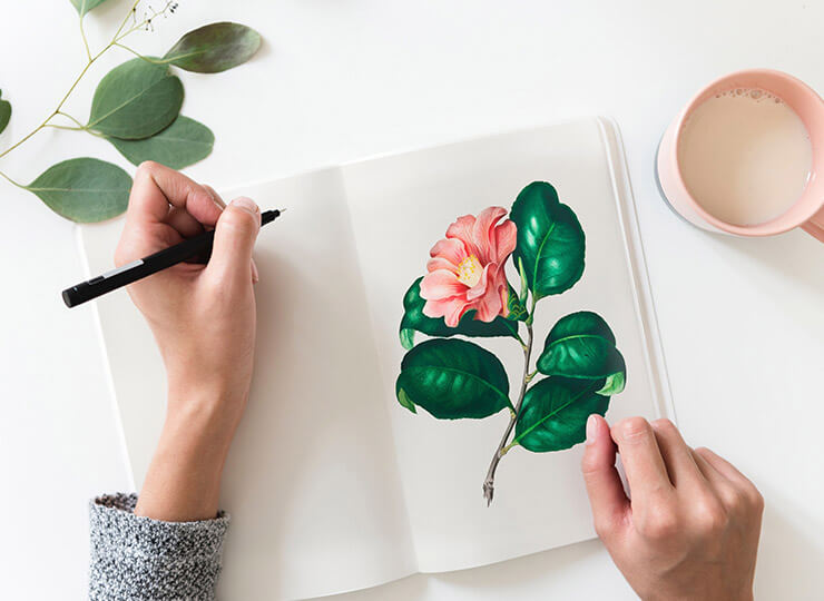 hand painting a flower